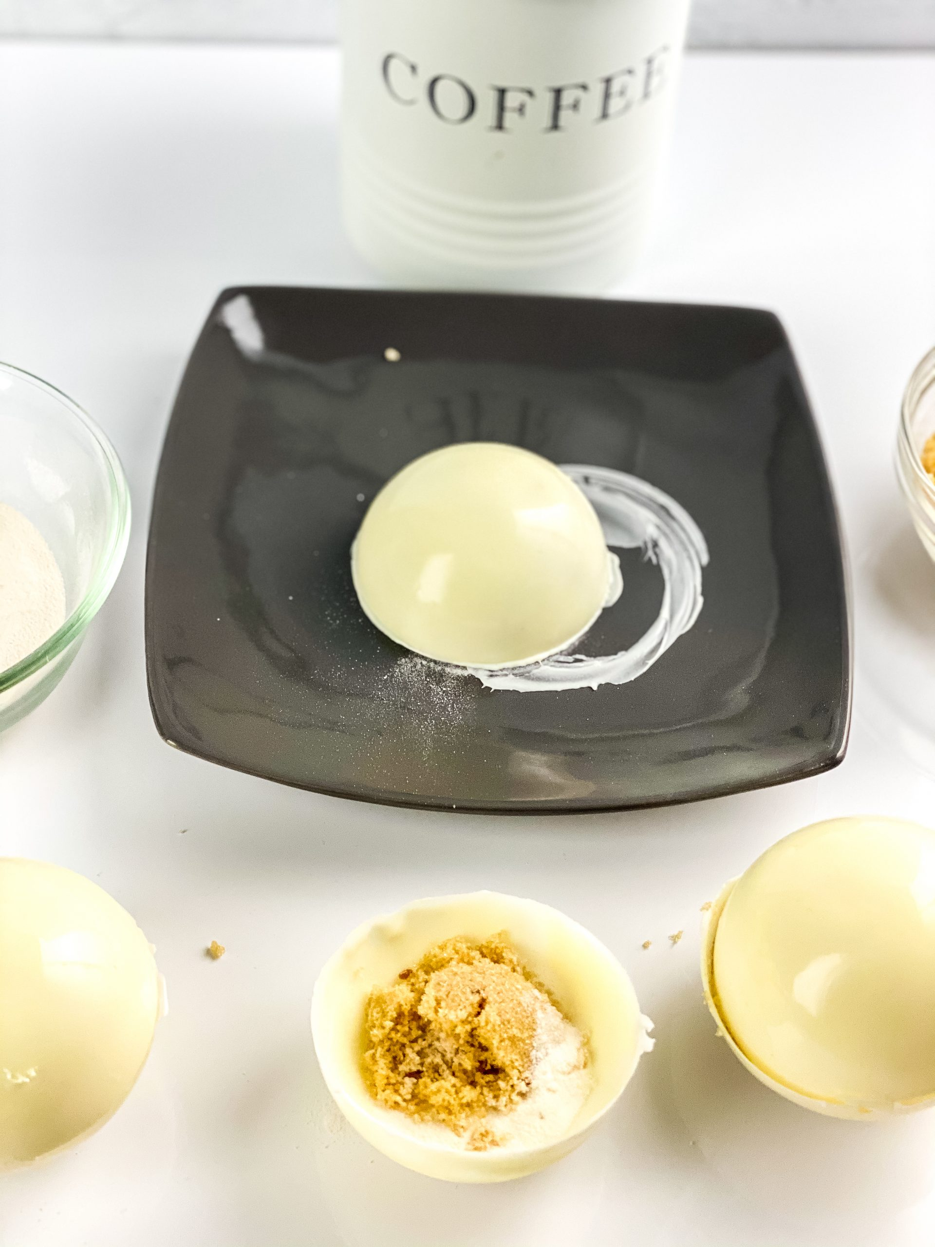 using a warming plate to seal the edges of the Irish coffee creamer bombs