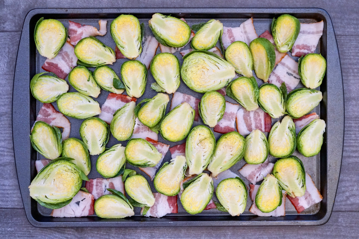 Brussels sprouts and bacon on a baking sheet