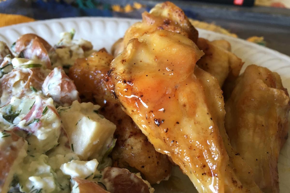 honey mustard chicken wings served with potato salad